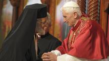 """Pope Benedict XVI (R) greets Gregorios III, Patriarch of the Church of Antioch, during a ceremony at the St. Paul Basilica in Harissa near Beirut September 14, 2012. Pope Benedict urged multi-faith Lebanon on Saturday to be a model of peace and religious coexistence for the Middle East, which he called a turbulent region that """"seems to endure interminable birth pangs"""". (OSSERVATORE ROMANO/Reuters)"""