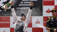 Williams Formula One driver Pastor Maldonado (L) of Venezuela is sprayed with champagne during the podium ceremony at the Circuit de Catalunya in Montmelo, near Barcelona, May 13, 2012. (Albert Gea/Reuters/Albert Gea /Reuters)