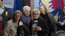 Supporters of President Barack Obama watch as elections results trickle in at a campaign office in Wooster, Ohio Tuesday, November 6, 2012. (Kevin Van Paassen/The Globe and Mail)