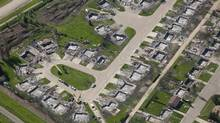 Burned-out homes from May's wildfire are shown in an aerial view of Slave Lake, Alta., prior to the arrival of the Duke and Duchess of Cambridge, July 6, 2011. (JONATHAN HAYWARD/THE CANADIAN PRESS/JONATHAN HAYWARD/THE CANADIAN PRESS)