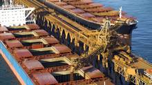 A bulk carrier is being loaded with iron ore from a Rio Tinto mine in West Australia's Pilbara region. (HO)