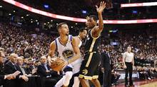 Golden State Warriors guard Stephen Curry (30) looks to shoot past Toronto Raptors guard Kyle Lowry (7) during second half NBA basketball action in Toronto on Wednesday, November 16, 2016. (Frank Gunn/THE CANADIAN PRESS)