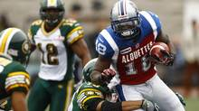 Montreal Alouettes' Jamel Richardson (18) runs with the ball against the Edmonton Eskimos during their CFL game in Montreal, October 28, 2012. (OLIVIER JEAN/REUTERS)