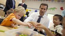 Ontario Premier Dalton McGuinty builds necklaces with Nathan Skinner, 3, left, and Alex You, 4, in a full day kindergarten class at Stoney Creek Public School in London, Ontario, October 8, 2010. (Geoff Robins for The Globe and Mail/Geoff Robins for The Globe and Mail)