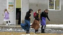 Young girls outside the school in the isolated religious community of Bountiful, B.C., Nov. 23, 2011. (Jonathan Hayward/ The Canadian Press/Jonathan Hayward/ The Canadian Press)