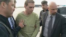 Luka Magnotta arrives at Mirabel International Airport in Montreal. Mr. Magnotta faces a preliminary inquiry on March 11, 2013, regarding charges of first-degree murder in the slaying and dismemberment of Chinese-born student Jun Lin last May (Montreal Police)