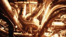 The snaking pipes of a factory. (John Foxx/Getty Images)