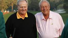 Golf greats Jack Nicklaus, left, and Arnold Palmer stand together on the first tee as they served as ceremonial starters to begin play in the 2010 Masters golf tournament. (SHAUN BEST/REUTERS)