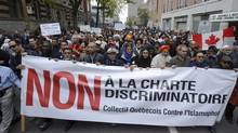 Demonstrators take part in a protest against Quebec's proposed Values Charter in Montreal on Sept. 14, 2013. (Ryan Remiorz/THE CANADIAN PRESS)