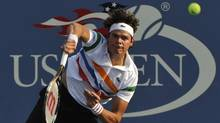 Milos Raonic of Canada serves to Paul-Henri Mathieu of France during their men's singles match at the U.S. Open tennis tournament in New York August 30, 2012. (RAY STUBBLEBINE/REUTERS)