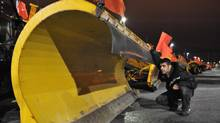 "Toronto Transportations"" Nick Trakosas inspects a plow at the Morningside yard ahead of Wednesday's snowstorm, in Scarborough, February 26, 2013. (J.P. MOCZULSKI for the Globe and Mail)"