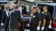 Pallbearers pull John Raposo's casket during funeral services at St. Mary's Catholic Church, Friday, June 22, 2012. Mr. Raposo was gunned down in Little Italy on Monday. (J.P. Moczulski For The Globe and Mail)