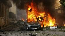 A car burns at the site of an explosion in Ashrafieh, east Beirut, October 19, 2012. At least two people were killed and 15 wounded in a roadside bomb that exploded in central Beirut on Friday, a security source said. (Hasan Shaaban/Reuters)