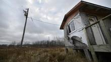 Loose housing wrap blows in the breeze on the Lake St. Martin reserve in Manitoba on Oct. 31, 2012. Since a flood in spring 2011, Lake St. Martin has been declared uninhabitable and officials have been working to find the First Nation a new home. (FRED LUM/THE GLOBE AND MAIL)