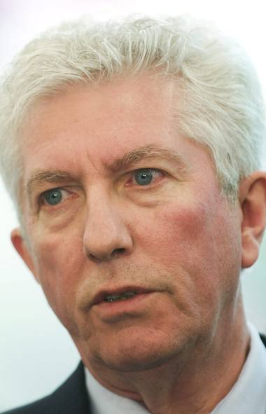 Bloc Quebecois leader Gilles Duceppe speaks to reporters during a federal election campaign stop at a Parti Quebecois national policy convention in Montreal, Sunday, April 17, 2011.