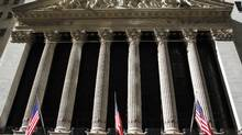 U.S. flags hang from the New York Stock Exchange building, February 15, 2011. (JOSHUA LOTT/REUTERS/JOSHUA LOTT/REUTERS)