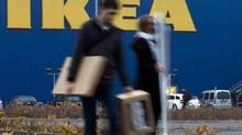 People walk in front of an IKEA shop in Berlin, Friday, Nov. 16, 2012. (Markus Schreiber/AP)