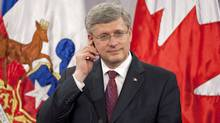 Prime Minister Stephen Harper listens to translation during a news conference at the Chilean presidential palace a in Santiago on April 16, 2012. (Adrian Wyld/Adrian Wyld/The Canadian Press)