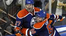 Edmonton Oilers' Dustin Penner, left, and Sam Gagner celebrate a goal against the Columbus Blue Jackets during the third period of their NHL hockey game in Edmonton October 22, 2009. (DAN RIEDLHUBER)