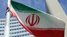 An Iranian flag flies in front of the building where closed-door nuclear talks take place in Vienna on July 2, 2014. (RONALD ZAK/ASSOCIATED PRESS)