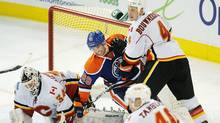 Calgary Flames' Jay Bouwmeester, right, defends goalie Miikka Kiprusoff from Edmonton Oilers' Sam Gagner during third period NHL hockey action in Edmonton on Saturday, Dec. 3, 2011. (John Ulan/The Canadian Press/John Ulan/The Canadian Press)