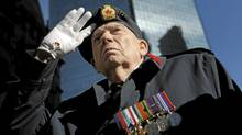 Harold Davis,87, stands at attention as the band played God Save the Queen during Remembrance Day ceremonies at Old City Hall in Toronto on Nov 11 2010. Davis served in the Royal CanadianCorp of Signals from 1939-1945 during the Second World War. (Fred Lum/The Globe and Mail/Fred Lum/The Globe and Mail)