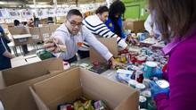Volunteers sort food at the Daily Bread Food Bank in Toronto, Ont., on Monday. The food bank is the largest provider of food relief in the Greater Toronto Area. (Kevin Van Paassen For The Globe and Mail)