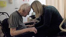 Brenda Joudrey, right, shares a moment with her father Clarence Young, 94, while in his semi-private room at the Halifax Infirmary at the QEII Health Sciences Centre on Dec. 16, 2016. (Darren Calabrese/The Globe and Mail)