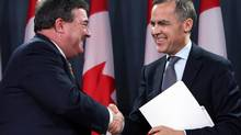 Canadian Finance Minister Jim Flaherty, left, shakes hands with Bank of Canada Governor Mark Carney after it was announced that Mr. Carney will be the new head of Bank of England, during a news conference in Ottawa, Monday Nov. 26, 2012. (FRED CHARTRAND/THE CANADIAN PRESS)