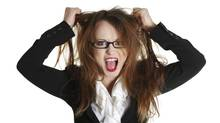 Angry, stressed woman tearing her hair (Piotr Marcinski/Getty Images/iStockphoto)