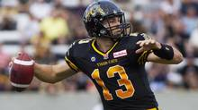 Hamilton Tiger-Cats quarterback Dan LeFevour looks to make a pass during their home opener against the Ottawa RedBlacks in CFL action in Hamilton, Ont., Saturday, July 26, 2014. (Aaron Lynett/THE CANADIAN PRESS)