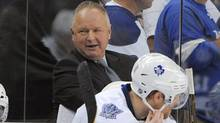 Toronto Maple Leafs coach Randy Carlyle, center, smiles as he talks with his team in the final seconds of their 3-1 win over the Tampa Bay Lightning in an NHL hockey game Thursday, March 15, 2012, in Tampa, Fla. (Brian Blanco/Associated Press)