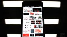 A photo illustration shows the Verizon wireless logos on a mobile phone screen. (MIKE BLAKE/REUTERS)