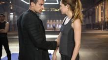 Theo James and Shailene Woodley in Divergent. (Jaap Buitendijk/eOne Films)
