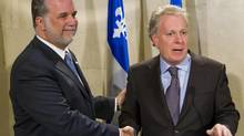 Philippe Couillard, shown with then-premier Jean Charest in 2008, is seen as a potential front-runner in the race to replace Mr. Charest as leader of the Quebec Liberal Party. (CLEMENT ALLARD/THE CANADIAN PRESS)