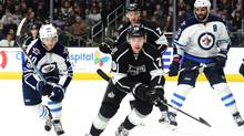 Tanner Pearson #70 of the Los Angeles Kings and Joel Armia #40 of the Winnipeg Jets chase after a rebound as Jeff Carter #77 and Dustin Byfuglien #33 of the Winnipeg Jets look on during the second period at Staples Center on March 23, 2017 in Los Angeles, California. (Harry How/Getty Images)