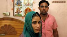 Ravinder Gehlaut and his wife, Shilpa Kadiyan, were forced to flee for their lives after their marriage was deemed sinful by a village council because they belong to the same clan. (Mustafa Quraishi/Associated Press/Mustafa Quraishi/Associated Press)