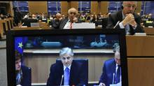 European Central Bank President Jean-Claude Trichet is seen on a TV screen during the meeting with European Parliament Committee on Economic and Monetary Affairs on Nov. 30, 2010, at the EU headquarters in Brussels. (GEORGES GOBET/Georges Gobet/AFP/Getty Images)