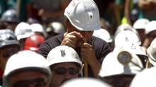 A miner leans on a cane during a protest against government austerity measures in Madrid. Spain has an unemployment rate of nearly 25 per cent - the highest unemployment rate in the 17-nation euro zone. (ANDREA COMAS/REUTERS)