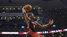 Toronto Raptors' DeMar DeRozan scores against Brooklyn Nets during first half NBA action in Toronto on Saturday January 11 , 2014. (Chris Young/THE CANADIAN PRESS)