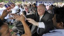 Toronto Mayor Rob Ford is greeted by enthusiastic fans at Ford Fest, held in Thomson Memorial Park in Scarborough, July 25, 2014. (J.P. MOCZULSKI For The Globe and Mail)