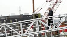 Prime Minister Stephen Harper walks down the gangway of the MV Ocean Lady following a photo opportunity in Delta, B.C. Monday, Feb 21, 2011. The MV Ocean Lady, which was carrying illegal immigrants to Canada, was seized and towed into a port in Victoria, B.C. by the Navy on Oct 17, 2009. (Jonathan Hayward/The Canadian Press/Jonathan Hayward/The Canadian Press)