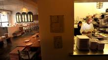 Eskender Aseged prepares for an evening service in the kitchen of Coffee Bar in San Francisco. (Noah Berger)