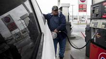 A customer fills up his truck at a gas station in Tacoma, Wash., in this file photo. (MATTHEW RYAN WILLIAMS/NYT)