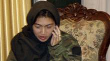 Canadian journalist Mellissa Fung speaks on her phone after being released in Kabul Nov. 8, 2008. (HO/REUTERS)
