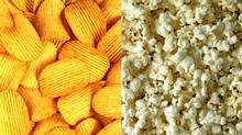 Substituting two cups of plain air-popped popcorn for 14 potato chips will save you 90 calories. (Photodisc/Siede Preis)