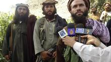 Pakistani Taliban group commander Mullah Dadullah (R), speaks to the media in the Afghanistan-Pakistan border area of Kunar and Bajaur tribal region in this September 6, 2011 file photo. A NATO air strike in eastern Afghanistan has killed a commander of the Pakistani Taliban, both NATO and the Taliban said on August 25, 2012. Both sides identified the dead commander as Mullah Dadullah and said several of his comrades were also killed in the attack on Friday. (Stringer/REUTERS)