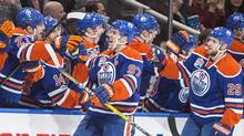 Edmonton Oilers' Connor McDavid (97) and Leon Draisaitl (29) celebrate a goal against the Vancouver Canucks during third period NHL hockey action in Edmonton, Alta., on Sunday April 9, 2017. (AMBER BRACKEN/THE CANADIAN PRESS)