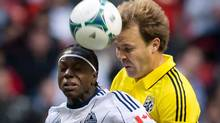 Vancouver Whitecaps' Darren Mattocks, left, of Jamaica, and Columbus Crew's Chad Marshall vie for the ball during the first half of an MLS soccer game in Vancouver, B.C., on Saturday March 9, 2013. The prediction was grandiose, to say the least, but Mattocks is standing by it.Heading into the 2013 MLS season, the Vancouver Whitecaps striker vowed to score 20 goals. But with Vancouver's campaign two games old, he has yet to put the ball in the back of the net. (DARRYL DYCK/THE CANADIAN PRESS)
