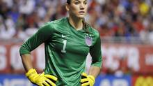In this Oct. 20, 2013, file photo, United States goalkeeper Hope Solo pauses on the field during the second half of an international friendly women's soccer match against Australia in San Antonio. (Darren Abate/AP)